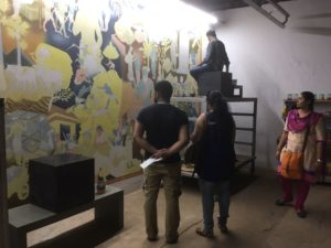 """Kochi muralist PK Sadanandan's """"12 Stories"""" (2016) was painted throughout the festival. The artist engaged with his audience, taking up not only the practice of traditional mural painting but also the question of caste depicted in the Parayi Petta Panthiru Kulam story he painted."""