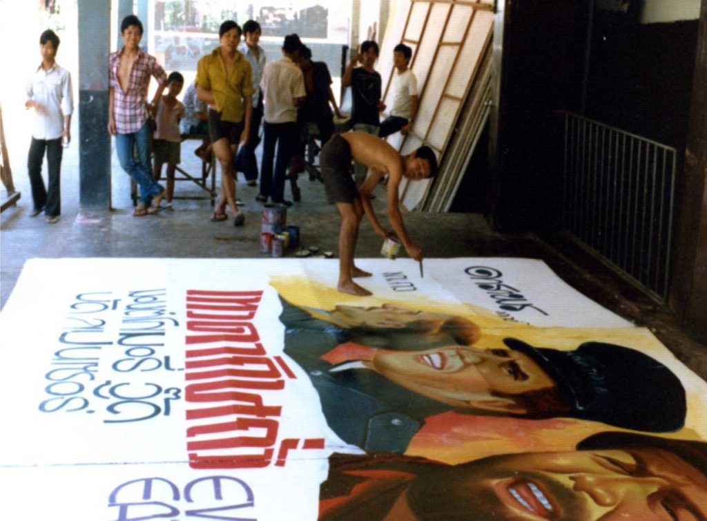 Billboard painters creating a sign for side billboard for the Spigetthi Western 'Even Angels Eat Beans' @ the Chalerm Thani Theater in Udon Thani. Courtesy of Craig Campen