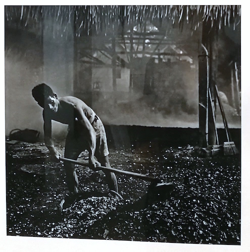 "Lui Hock Seng, ""Man burning crushed cockle shells to make whitewash paint, Tanah Merah"" c. 1960s - 1970s"